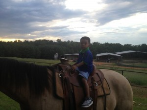 The littlest Moore got to ride the biggest horse!